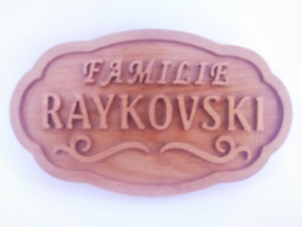 Wooden door sign with embossed letters